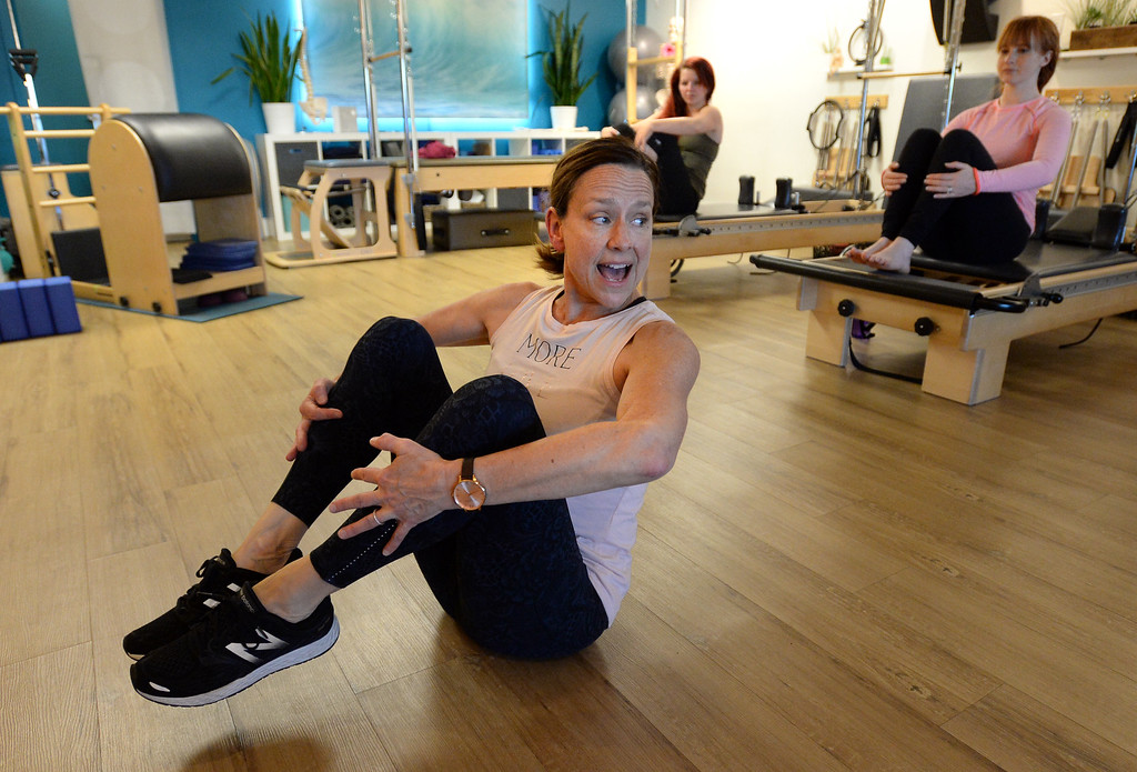 . LOUISVILLE, CO: November 6: Instructor, Tracy Bodder, teaches class on Tuesday. Center Stream Pilates, in Louisville, is the Workout of Week. (Photo by Cliff Grassmick/Staff Photographer)