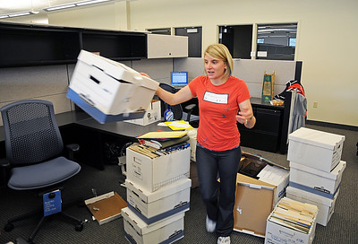 Freestyle's Cheryl Bilisoly moves boxes during the move-in to the USSA's new Center of Excellence in Park City, Utah.