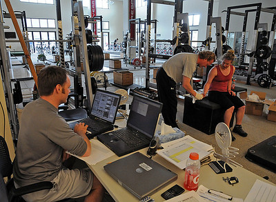 U.S. Ski Team sport science staff Ernie Rimer (left) and Per Lundstam work with alpine ski racer Stacey Cook during a testing camp at the new USSA Center of Excellence.