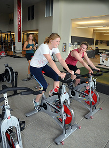 U.S. Ski Team alpine ski racers Kaylin Richardson (left) Stacey Cook (right) and Resi Stiegler (rear) hop on the stationary bikes at the Team's new Center of Excellence in Park City, Utah.