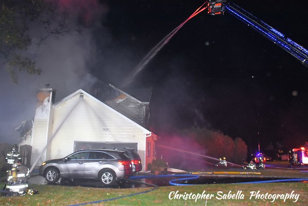 Centereach fire  4 people escape