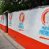Political advertisement on walls of small Mayan village on shore of Lake Atitlan for the Patriotic Party of Guatemala.