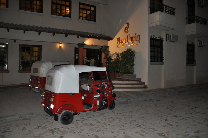 We arrive, by two Tuk Tuks (one for us; the other for our luggage) from the bus station, at the Plaza Copan Hotel on the main square in Copan Ruinas. Our room for the first night is the right hand window on the ground floor