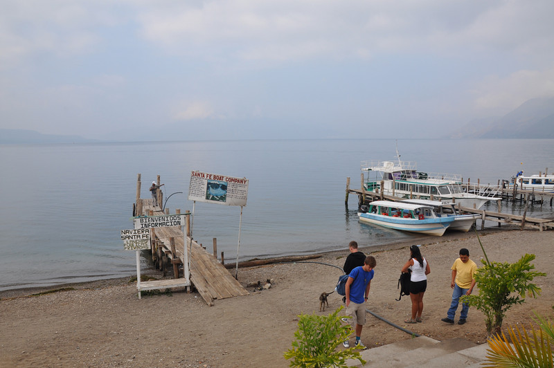 We await to go-ahead to board our Lake Atitlan boat which is second from the left in this picture. Also waiting on the beach are some of our fellow passengers