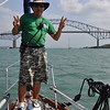 Our Panama Canal 'adviser' on the bow of Briet as we near the Bridge of the Americas
