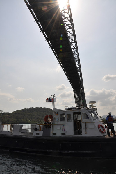 As we sail beneath the Bridge of the Americas our 'pilot' boat comes alongside to take off our 'adviser'