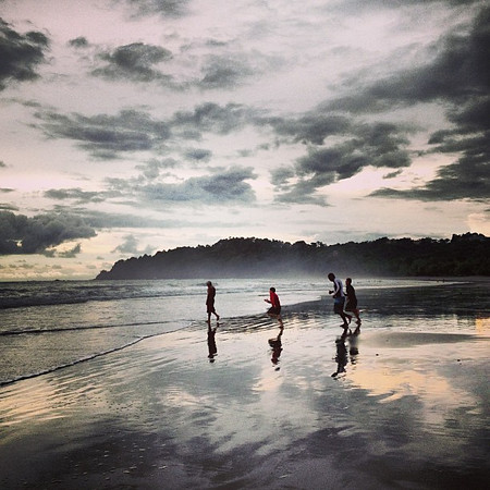 Time to hit the surf! Mixed sky, late afternoon at Playa Manuel Antonio, Costa Rica.
