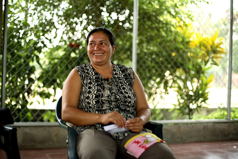 Interviewer / editor: Caroline Cargo   <b><i><u>Julia Garcia</b></i></u>, a mother of three, and a resident of La Limonera, is a leader in Mujeres Ganaderas, a cattle cooperative organized by and for women in the Bajo Lempa region.  Currrently she participates in a project to exhume, re-bury with dignity, and remember victims of the La Quesera massacre which occurred in October, 1981, and in which most of her brother's family was killed along with many neighbors.  ---------  <i><strong>Introduction</i></strong>  By the time we arrived at the offices of the Mujeres Ganaderas, a cattle cooperative organized by and for women in a rural community in the Bajo Lempa, we had endured a long and bumpy, hot and sweaty drive by car from San Salvador.   Julia Garcia was already waiting for us.  We passed by Julia's bicycle leaned up against the side of the two story building and walked around back to the edge of a field and the outdoor meeting space.  While we organized ourselves there in that open-air, covered pavilion completely enclosed by metal bars from floor to ceiling, a small herd of cattle and a horse roamed freely around us, grazing in the already oppressive heat of the morning sun.  From the few facts I had previously received about her, I already knew that Julia was young during the war, that many of her family of origin had died in the Massacre of La Quesera in the mountains north of the Bajo Lempa, and that today she is active in the massacre survivors group and a leader in the Mujeres Ganaderas.    While we waited for the equipment to be set up, we introduced ourselves.  Julia told me the names of her three children:  Franklin (20), Oscar Antonio (18), and her daughter Fatima (4).  I showed her a photo of my husband and our three daughters who are 20, 18, and 16.  Motherhood.  Common ground.  Familiar territory in this unfamiliar setting.    We sorted out logistics and agreed we would take a break after the first part of our interview session.  There was a small place just a short walk up the road where we could have grilled chicken or fried fish for lunch.  And then, time permitting, I would have a chance to go with Julia to her home in the nearby community of La Limonera to meet Franklin and Fatima in person, as well as Julia's sister Irma, before returning to the microphones and questions to complete our work.  With our agenda thus comfortably arranged, we began. And all too quickly I sensed a deep discomfort rise again as I listened and confronted the reality that, in the same years during which I had been a privileged student at an elite women's college in Massachusetts, and I must confess, completely ignorant of the situation unfolding miles away in El Salvador, Julia, now sitting just an arm's length away from me, had been literally fighting for her life.  What follows is in her words.