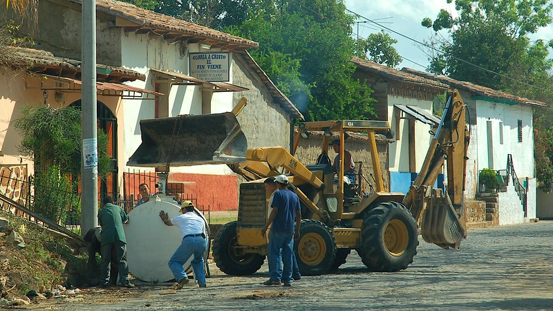 The next day we drove back through Suchitoto, where local roadworks were underway.
