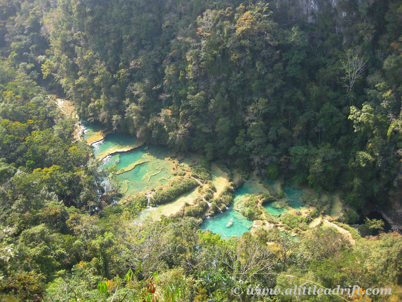 Semuc Champey and stair-step lakes form turquoise pools down below