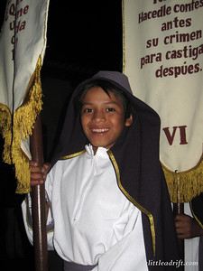 A Smile for the Camera during a Somber Procession
