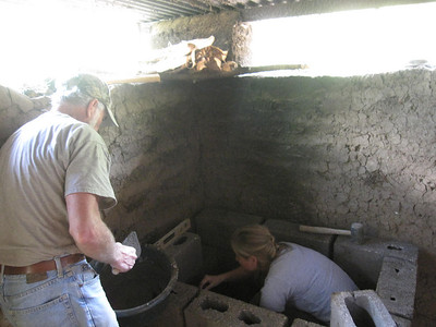 Applying concrete mortar to stove