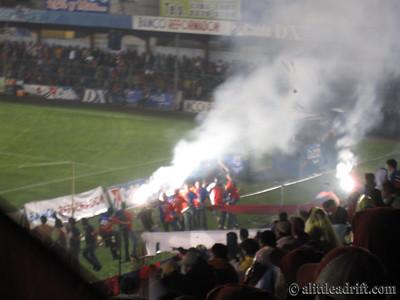 Fans Light Flares and Fireworks