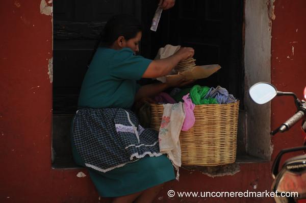 Guatemalan Woman and Tortillas - Antigua, Guatemala