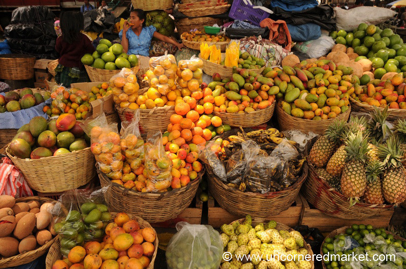 Overflowing Fruit Baskets at Antigua Market, Guatemala