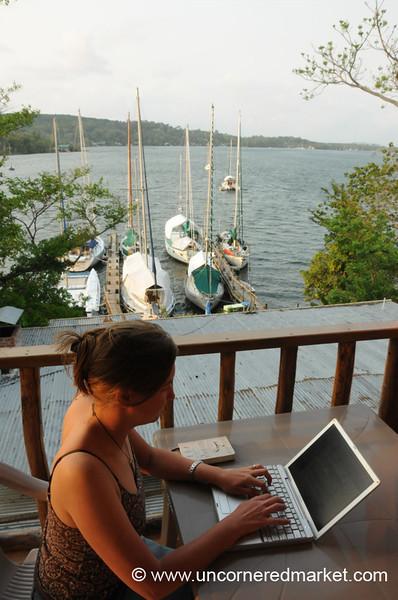 Digital Nomad, Audrey on Laptop - Rio Dulce, Guatemala