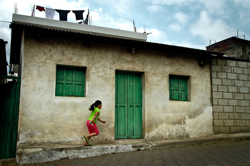 Little girl running through the town of Santiago de Atitlan.