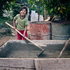 Girl helps mix concrete