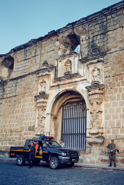 Military & police guard a cathedral for an unknown reason.