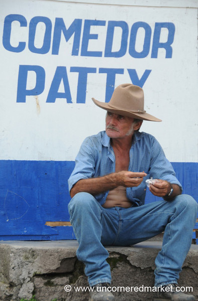 Honduran Man Having a Snack - Copan Ruinas, Honduras