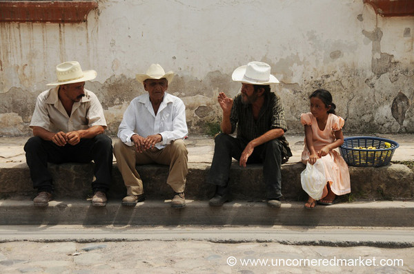 Hondurans on Street Curb - Copan Ruinas, Honduras