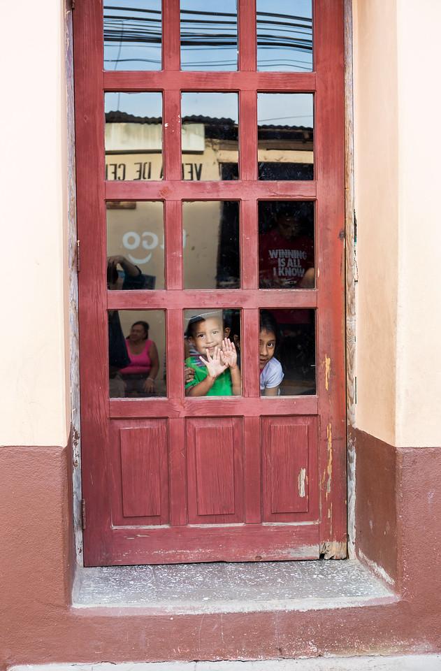 Kids in doorway.
