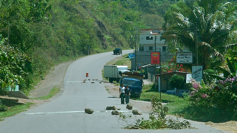 """And then you'd round a corner and come to a quick halt.   The informal """"traffic"""" markers -- branches down in the road and rocks across blocking part of it -- would warn you to be careful."""
