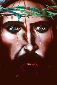 "Close-up of actual ""Jesus Painting"" for sale on street.  Yes, the eyes do follow you."