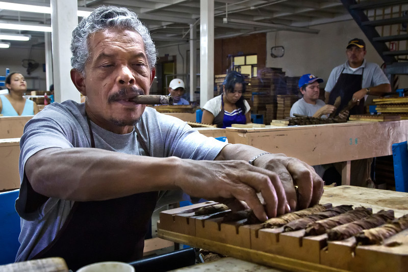 Molding the cigars.