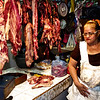 Meat lady at market in Managua.