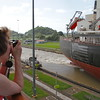 Donna takes a photo of the freighter ship in the lane next to Silver Cloud.
