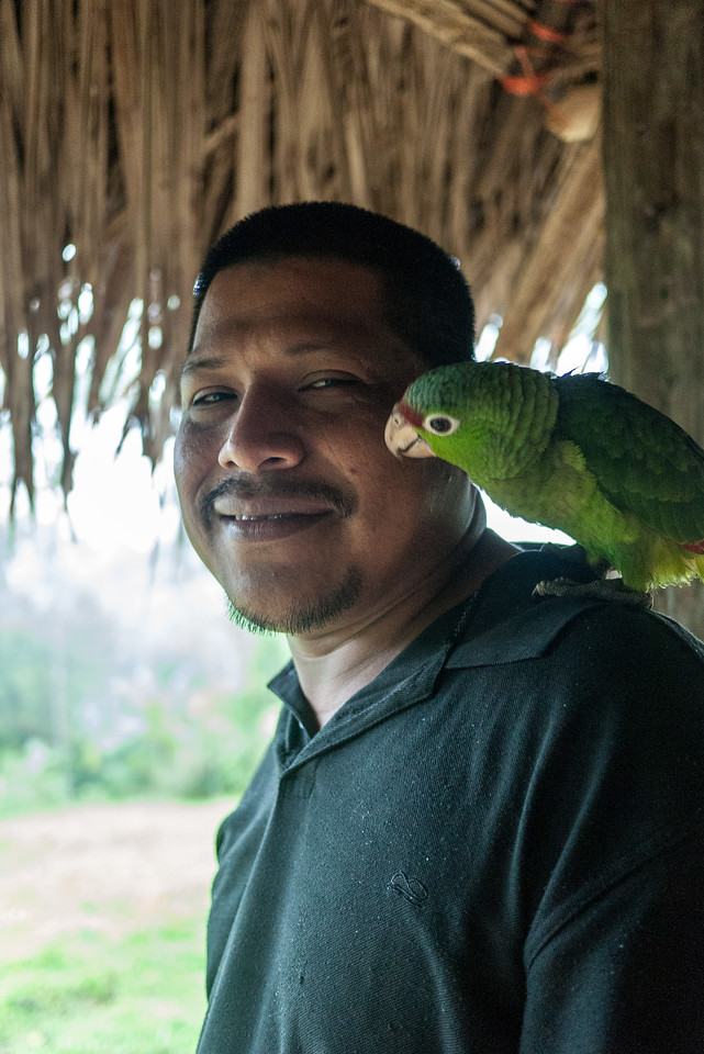 Eduardo and his pet bird at Silico Creek, Panama.