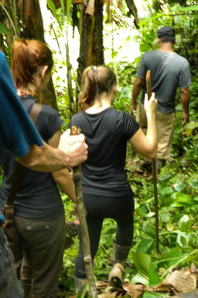 Hiking through the mud to the waterfall near Silico Creek, Panama.