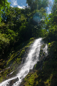 Silico Creek's pretty waterfall on a sunny day.