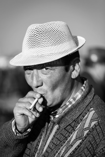 Man with Cigarette, Sunday Livestock Bazaar, Karakol, Kyrgyzstan