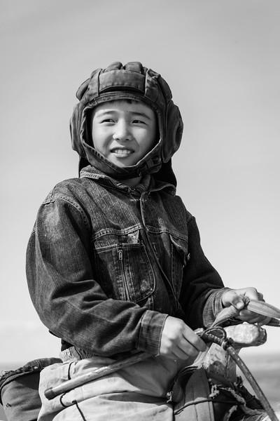 Boy with Soviet Tank Helmet, Nowruz, Temirlan