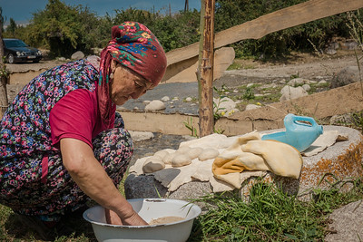 A woman preparing whole-grain bread