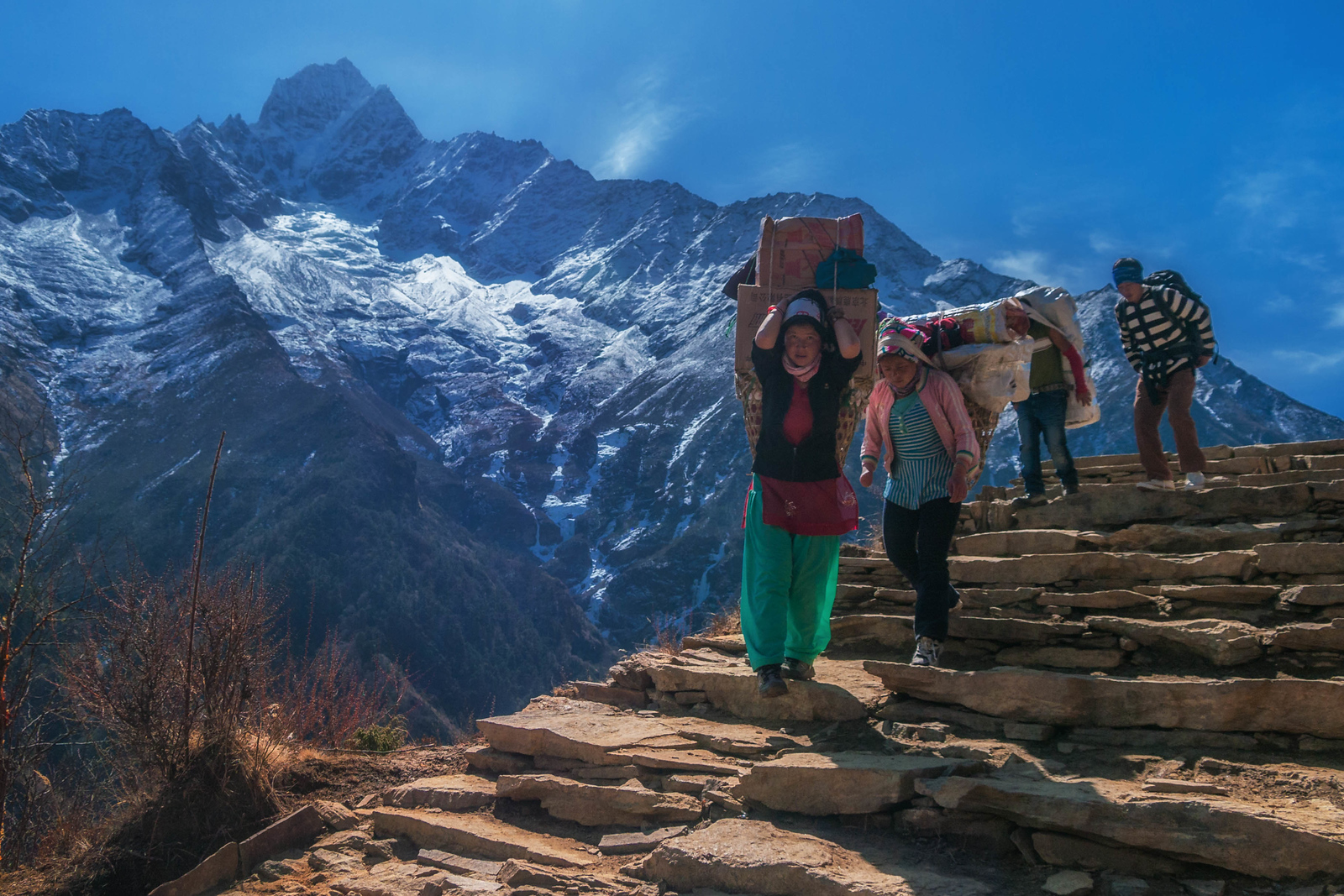 Porters carry heavy loads up and down to Mount Everest Base camp
