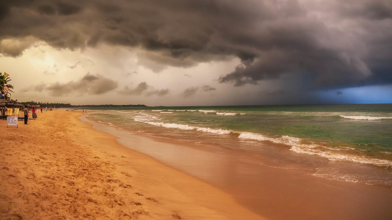 A storm rolls in over the beach in Hikkadua, Sri Lanka