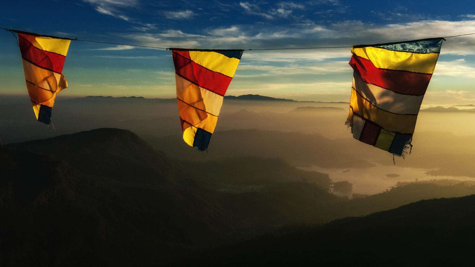 Prayer flags blow in the wind on Adams Peak