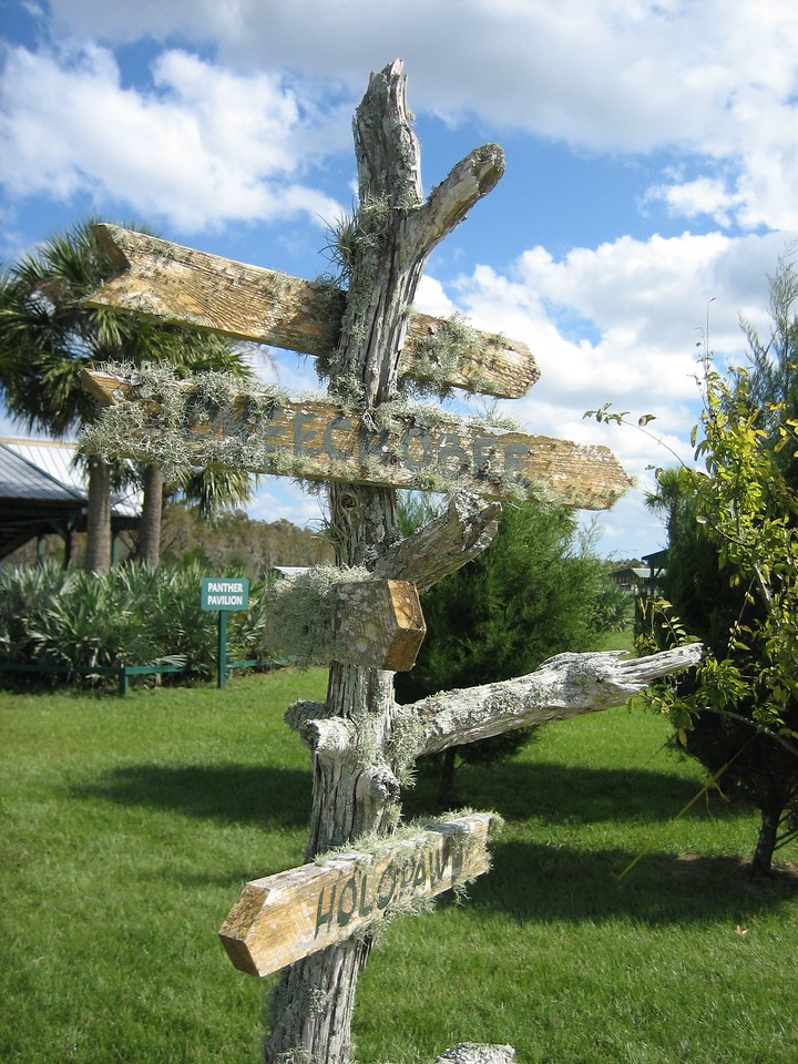 Signpost at the Cypress House <br /> location: Forever Florida<br /> PHOTO CREDIT: Sandra Friend / Florida Trail Association