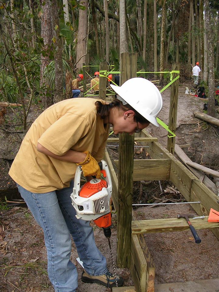 Drilling the sills<br /> PHOTO CREDIT: Roger Werner / Florida Trail Association
