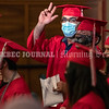 AUGUSTA, ME - JUNE 25: Mustafa Abdul Kareem and other graduates wave at friends and family in the audience  after getting their diplomas during Augusta adult education graduation Friday June 25, 2021 at Cony High and Middle School in Augusta. (Staff photo by Joe Phelan/Staff Photographer)