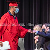 AUGUSTA, ME - JUNE 25: Mustafa Abdul Kareem, left, fist bumps Academic Coordinator Mike Emery after getting his diploma during Augusta adult education graduation Friday June 25, 2021 at Cony High and Middle School in Augusta. (Staff photo by Joe Phelan/Staff Photographer)