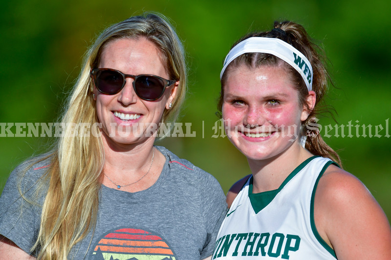 WINTHROP, ME - OCTOBER 6: Former record holder Emily Dooling Hamilton, class of 2001, left, poses with Maddie Perkins who beat her old record during half time ceremony at a field hockey game Wednesday October 6, 2021 on Kelsey Ann Stoneton Memorial Field in Winthrop. (Staff photo by Joe Phelan/Staff Photographer)