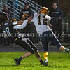 READFIELD, ME - OCTOBER 1: Maranacook's Chris Reid slips away from grasp of Boothbay's Ashton McLellen while running the ball during a football game Friday October 1, 2021 at the Ricky Gibson Field of Dreams in Readfield. (Staff photo by Joe Phelan/Staff Photographer)