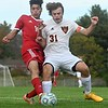 Cony's Saged Albadri, left, and Winslow's Zack St. Pierre battle for the ball during boys soccer action Monday in Augusta.  — Rich Abrahamson/Morning Sentinel