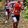 Skowhegan's Patrick McKenney races in the Kennebec Valley Athletic Conference cross country championship Saturday at Cony High School in Augusta.   — Joe Phelan/Kennebec Journal