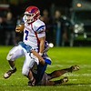 Messalonskee quarterback Brady Doucette (7) gets tackled by Lawrence defensive back Parker Higgins during a football game Friday at Keyes Field at Lawrence High School in Fairfield.   — Joe Phelan/Kennebec Journal