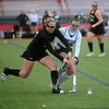Maranacook's Kaleigh Kubicki, left, and Winthrop's Emma Shuman compete for the ball during a Class C South quarterfinal field hockey game Wednesday afternoon at Thomas College in Waterville.  — Rich Abrahamson/Morning Sentinel